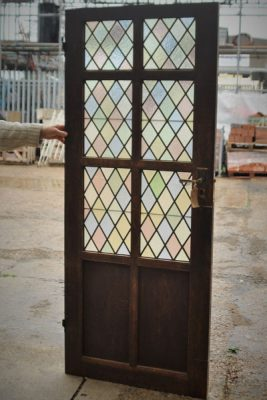 reclaimed wood door with stained glass