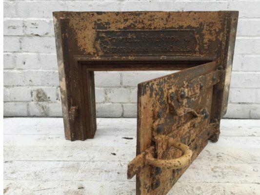 Antique cast iron oven door